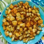 air fryer cajun diced potatoes on plate with decor pin