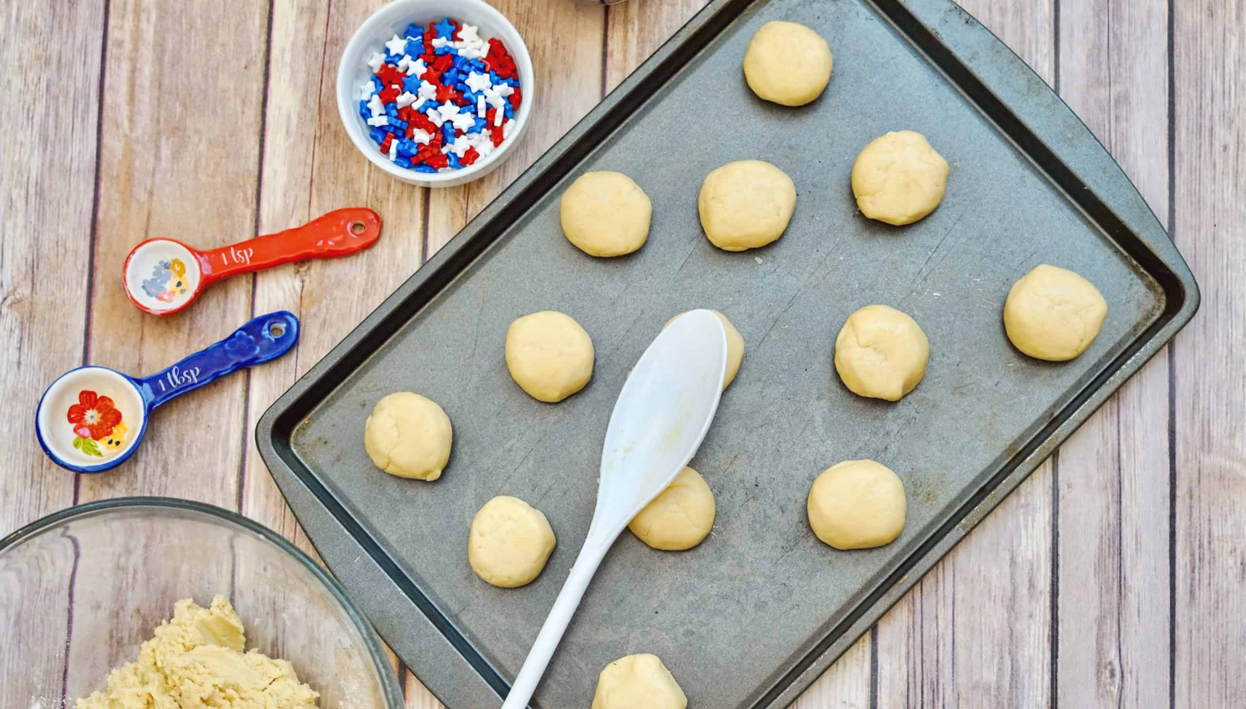 patriotic sugar cookie dough balls on cookie sheet