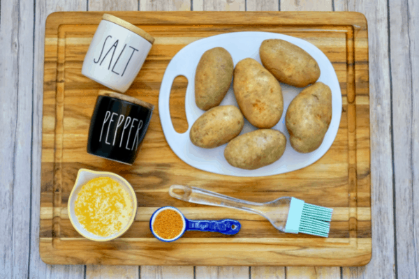 Russet cajun potatoes recipe ingredients on a wooden cutting board