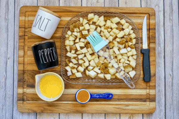 diced russet cajun potatoes in pan with ingredients