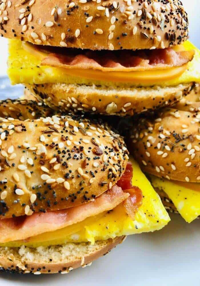 three gluten free bagel breakfast sandwiches