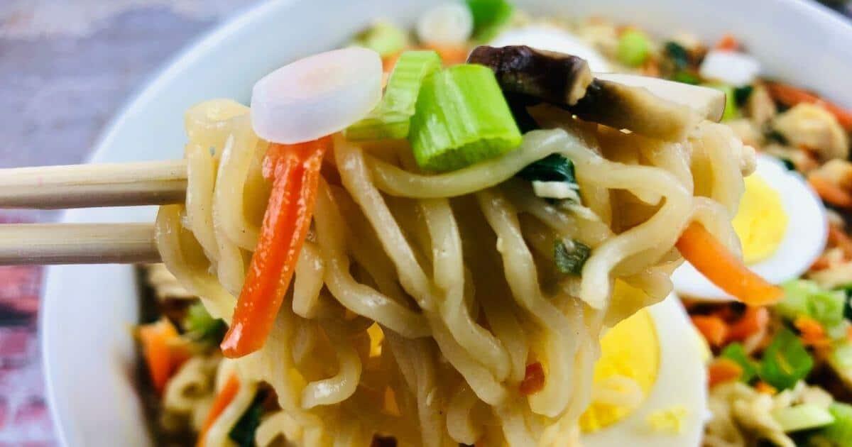 gluten free ramen noodles being served with chopsticks