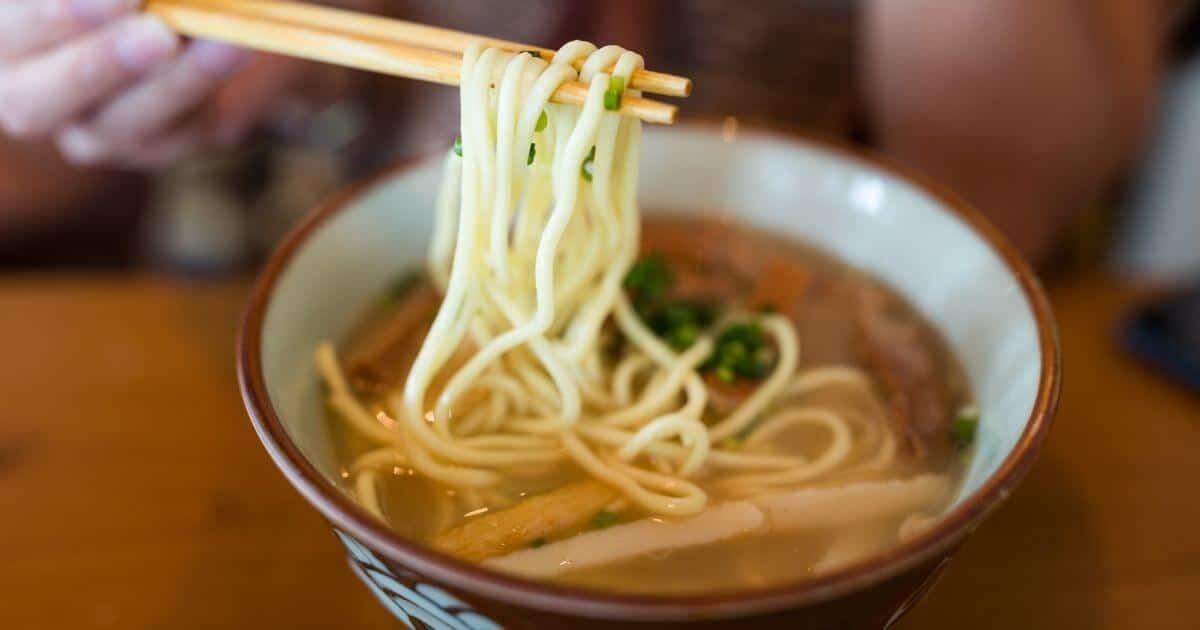 bowl of gluten free ramen noodles with chopsticks serving the noodles