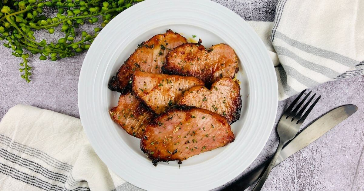 gluten free air fryer ham on plate with place setting