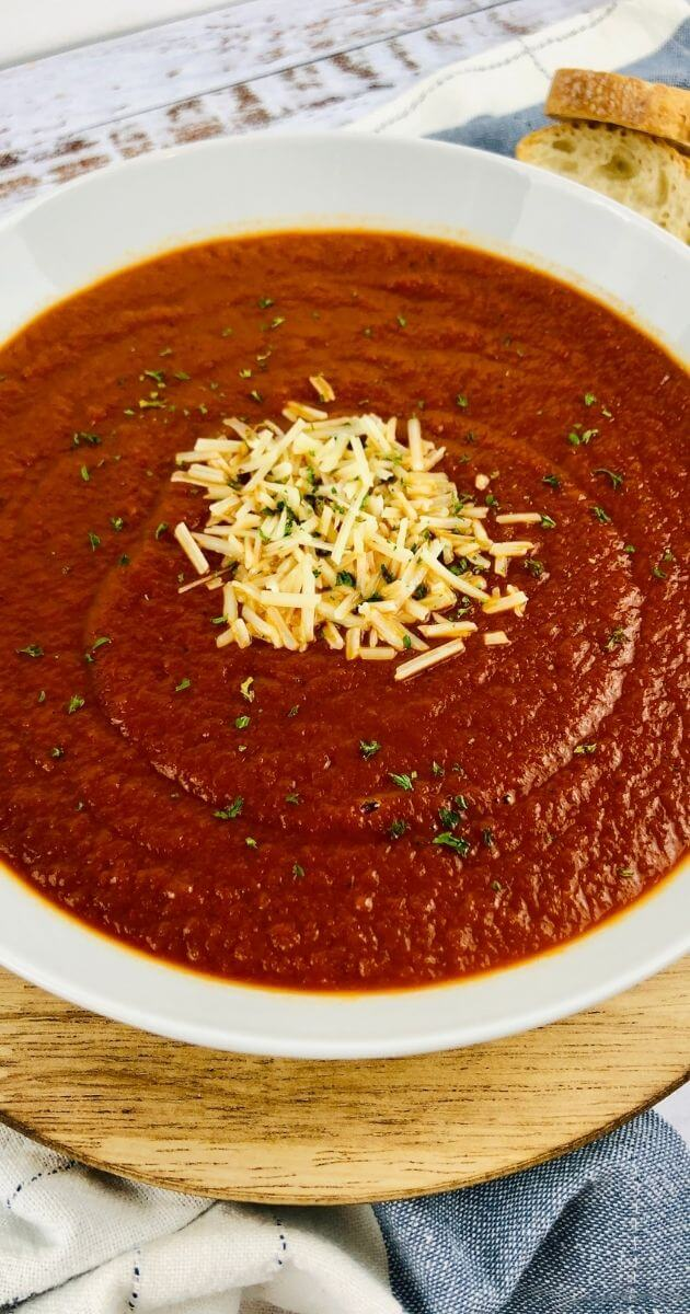 close up view of gluten free tomato soup with cheese on top